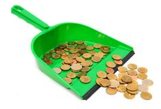 Scoop and coins. On a white background. royalty free stock photography