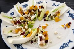 Scoop of Delicious. Endives with pomegranate, apricots, and gorgonzola Stock Photos
