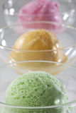 Scoop of delicious real fresh ice cream in Mango, Strawberry and Pistachio flavour. Stock Image