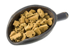 Scoop of dog food Stock Image