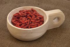 Scoop of dried Tibetan goji berries (wolfberries) Royalty Free Stock Photos