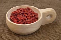 Scoop of dried Tibetan goji berries (wolfberries) Royalty Free Stock Photos