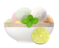 Scoop of fruit ice cream with mint herb and lime in plate isolat Royalty Free Stock Images