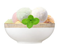 Scoop of fruit ice cream with mint herb in plate isolated on whi Stock Photo
