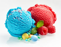 Scoop of gourmet bubblegum and raspberry ice-cream. Scoops of gourmet bubblegum and raspberry Italian artisanal ice-cream with sugar coated candy and fresh fruit Stock Image