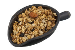 Scoop of granola with nuts, seeds and raisins stock photo