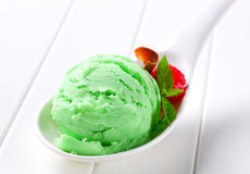 Scoop of green ice cream Royalty Free Stock Images