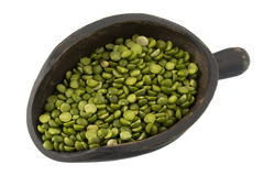 Scoop of green split peas Stock Photography