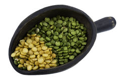Scoop of green and yellow pea Royalty Free Stock Image