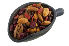 Scoop of healthy nuts and dried berries stock photos
