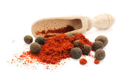 Scoop in heap of pepper. Wooden scoop in heap of pepper with peppercorns of sweet papper Royalty Free Stock Photo