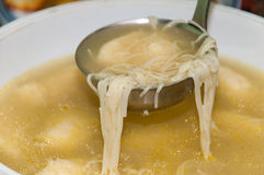 A scoop of homemade chicken soup Stock Photo