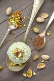 Scoop of homemade pistachio ice cream with chopped pistachios and chocolate Stock Photos