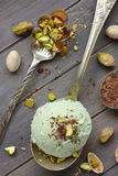 Scoop of homemade pistachio ice cream with chopped pistachios and chocolate Royalty Free Stock Images