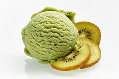 Scoop of ice cream. Scoop of green ice cream with kiwi flavour and slices of kiwi fruit in section close-up  on white background Stock Photography