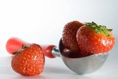 Scoop of ice cream and strawberries Stock Photo