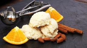 Scoop of orange ice cream with almond and chocolate Stock Photo