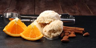 Scoop of orange ice cream with almond and chocolate. Scoop of orange ice cream Royalty Free Stock Photography