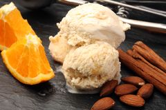 Scoop of orange ice cream with almond and chocolate. Scoop of orange ice cream Royalty Free Stock Images