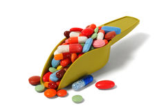 Scoop with pills Royalty Free Stock Photography