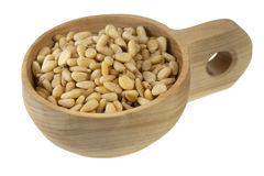 Scoop of pine nuts Stock Image