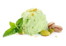 Scoop of pistachio ice cream with nuts and mint. On white background Stock Images