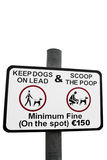 Scoop the poop sign. Warning sign for all dog owners to scoop the poop with a clipping path Royalty Free Stock Images