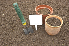 Scoop and pots for seedlings. Closeup Stock Photo