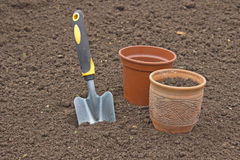 Scoop and pots for seedlings. Closeup Stock Image