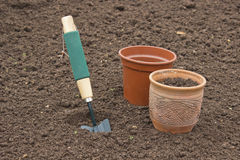 Scoop and pots for seedlings. Close-up Royalty Free Stock Images