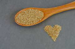 Scoop of Raw Quinoa Grains and Grains in Heart Shape Stock Photos
