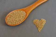 Scoop of Raw Quinoa Grains and Grains in Heart Shape Royalty Free Stock Image