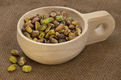 Scoop of raw shelled pistachio nuts Royalty Free Stock Photo