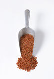 Scoop of red rice Royalty Free Stock Images