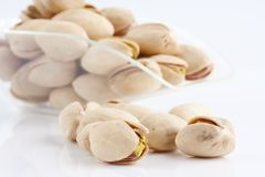 Scoop of roasted and salted pistachios Royalty Free Stock Image