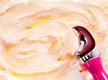 Scoop Serving Orange and Yellow Swirled Ice Cream Royalty Free Stock Images