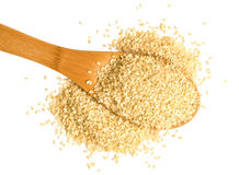Scoop of sesame seeds on white background Royalty Free Stock Photo