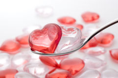 Scoop the Small heart shape sundries with a spoon. Small heart-shaped goods Stock Photos