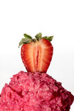 Scoop of strawberry ice cream with half strawberry on top. On a white background Stock Image