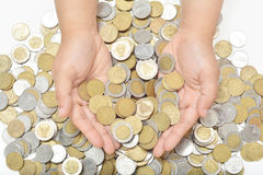 Scoop up coins from the pile Royalty Free Stock Image