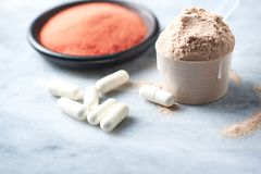 Scoop of Whey Protein, Beta-alanine capsules and Creatine Powder. Sport nutrition. royalty free stock images