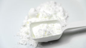 Scoop of White Collagen amino protein powder with spoon isolated Stock Photography
