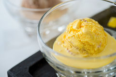 Scoop of yellow ice cream in a bowl. Macro Royalty Free Stock Photography