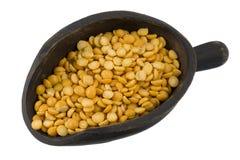 Scoop of yellow split peas Royalty Free Stock Image