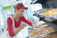 Scooping amount of food. Work royalty free stock images