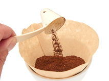 Scooping grinded coffee in a filter. Coffee measuring scoop putting grinded coffee in a filter Stock Photo