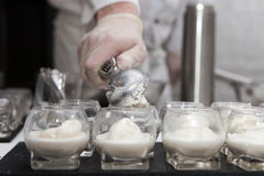 Scooping ice cream into glass, catering stock images