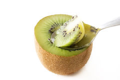 Scooping Kiwi fruits Royalty Free Stock Photo