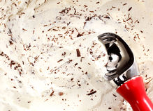 Scooping Vanilla Ice Cream with Chocolate Shavings Royalty Free Stock Photography