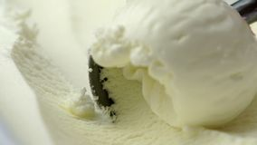 Scooping vanilla ice cream close up. 4K, HD, high definition 1080p stock video